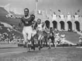 Los Angeles 1932: Lauri A Lehtinen of Finland leads the field in the 5,000m event and continues to cross the line first and win the gold medal with a time of 14:30.0 minutes.