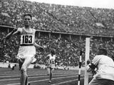 Berlin 1936: Lehtinen of Finland is timed at the tape by a judge trying to be as accurate as possible in the 5,000m final.
