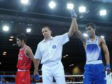 Referee annonces Vikas Krishan(R) of India wining the Light 60kg boxing bronze medal match