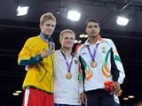 Gold medalist Evaldas Petrauskas (C) of Lithuania, silver medalist Brett Mather (L) of Australia, bronze medalist Krishan Vikas of India