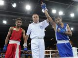 Referee annonces Hoorboyev Zohidjon(R) of Uzbekistan wining the Light Fly 48kg boxing bronze medal match