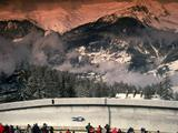 General view of a competitor in action during the men's single luge event with an amazing backdrop the sun setting over the French Alps.