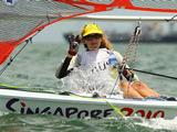 Madison Kennedy of Australia waves to the media in the Girls Byte CII one person dinghy class race