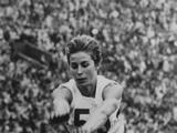 Tokyo 1964: Mary Rand of Great Britain in action during the long jump event. She finised with a world record jump of 22 feet, 2 inches to win the gold medal.