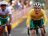 Australia's Jay McCarthy (right) overtakes Bolivia's Samuel Melgar (left) as he approaches the finishing line in the junior men's cycling time trial. Portugal's Rafael Ferreira Reis won the event with a timing of 3min 56.64sec.