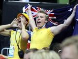 Supporters from the Australian team cheer on Emma McKeon during the youth women's 100m freestyle semi-finals. She was placed first overall and qualifys for the finals.