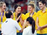 The Australia's girls' basketball team receives their silver medal after the girls' basketball finals