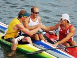 (L to R) Ken Wallace celebrates with bronze medalist Tim Brabants of Great Britain and silver medalist Adam van Koeverden of Canada after winning the Men's Kayak Single K1 Flatwater Final atthe Beijing 2008 Olympic Games.