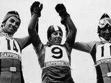 Sapporo 1972: The medallists of the men's giant slalom, Swiss skier Edmund Bruggmann (silver), Italian skier Gustav Thoni (gold), and Swiss skier Werner Mattle (bronze) raise their arms in celebration of their medals.