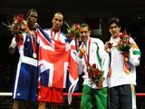 (L-R) Silver medalists Emilio Correa Bayeaux of Cuba, gold medalist James Degale of Great Britain and bronze medalists Darren John Sutherland of Ireland and Vijender Kumar of India pose during the medal ceremony for the Men's Middle (75kg) Final Bout.