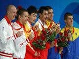 (L-R) Silver medalists Yuriy Kunakov and Dmitry Sautin of Russiai, gold medalists Kai Qin and Feng Wang of China and bronze medalists Illya Kvasha and Oleksiy Prygorov of Ukraine stand on the podium during the medal ceremony in the Men's Synchronised 3m Springboard Final held at the National Aquatics Center.