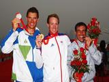 (L-R) Silver medalist Vasilij Zbogar of Slovenia, gold medalist Paul Goodison of Great Britain and bronze medalist Diego Romero of Italy celebrate with their medals for the Laser class event held at the Qingdao Olympic Sailing Center during day 11 of the Beijing 2008 Olympic Games on August 19, 2008 in Qingdao, China.
