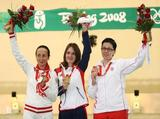 Katerina Emmons (C) of Czech Republic celebrates winning the gold medal in the Women's 10m Air Rifle Final with Silver medallist Lyubov Galkina (L) of Russia and Bronze medallist Snjezana Pejcic of Croatia.