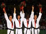 (L-R) Silver medalist Karine Sergerie of Canada, gold medalist Hwang Kyungseon of South Korea and bronze medalists Gwladys Patience Epangue of France and Sandra Saric of Croatia celebrate after the Women's Taekwondo 67kg Final.