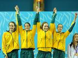 Australian swimmers (left to right) Madison Wilson, Emily Selig, Zoe Johnson and Emma McKeon raise their arms in victory before receiving their gold medal for the Youth Women's 4x100m Medley Relay finals. Australia took the gold after China was disqualified from the race.