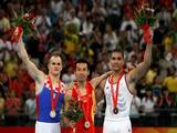 (L-R) Silver medalist Filip Ude of Croatia, gold medalist Xiao Qin of China and bronze medalist Louis Smith of Great Britain pose for a photo after the individual men's pommel horse final in the artistic gymnastics event held in National Indoor Stadium on Day 9 of the Beijing 2008 Olympic Games on August 17, 2008 in Beijing, China.
