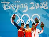 (L-R) Silver medallist Anh Tuan Hoang of Vietnam, Gold medalist Long Qingquan of China and Bronze medalist Eko Yuli Irawan of Indonesia pose on the podium during the medal ceremony for the men's 56kg group.