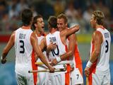 Taeke Taekema of The Netherlands celebrates a goal with teammates during their match against South Africa .