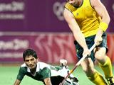 Pakistan's Muhammad Usman Aslam (left) dives to steal the ball from Australia's Rory Middleton in the Pakistan vs Australia boy's preliminary hockey match. Australia won the match 5-2.