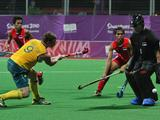 Singapore goalkeeper Ong Pang Chian Samudra (right in black) blocks a shot on goal by Rory Middleton of Australia (#9) in the Boy's Preliminaries 3 match. Australia won the match 8-1.