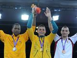 Gold medalist Damien Hooper stands on the podium during the awarding ceremony of the Middle 75kg Boxing.