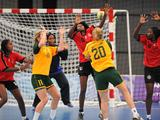 Monica Najdovski (right, in yellow) throws the ball past Angola players to score