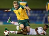 Aaron Mooy of the Olyroos is tackled by Mohsen M H Mohammed of Yemen during the 2nd leg of the 2012 London Olympic Games Asian Qualifier match between the Australian Olyroos and Yemen.