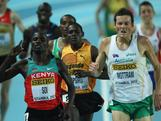 Craig Mottram and Edwin Shoi of Kenya race for the line in the Men's 3000 Metres first round during the 14th IAAF World Indoor Championships on March 9, 2012 in Istanbul, Turkey.