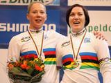 Kaarle McCulloch and Anna Meares of Australia sing the national anthem on the podium after winning the Women's Team Sprint on day two of the UCI Track World Championship at the Omnisport arena in Apeldoorn, Netherlands.
