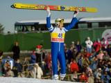 Matti Nykanen of Finland holds his skies aloft after the 90m ski jump where he won the gold medal with a jump of 224m.
