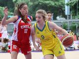 Chile's Garcia Katalina (left) fights for the ball with Australis's Olivia Bontempelli in a preliminary girls' basketball match. Australia beat Chile 12-4.