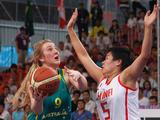 Olivia Bontempelli (#9 on left), tries to get the ball past China`s Jin Jiabao (#5) during the girl`s basketball gold medal match. China won the gold by beating Australia 33-29.
