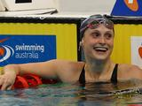 Olivia Halicek reacts after winning the final of the Women's 50 Metre Freestyle during the 2011 Australian Swimming Championships at Sydney Olympic Park Aquatic Centre