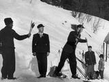 Oslo 1952: The Olympic Flame is brought out from the hearth of the old cottage of Sondre Norheim in Morgedal, Telemark, from where it was carried by a relay of top Norwegian skiers to the Bislett Stadium in Oslo. Born in 1825, Norheim is known as the pioneer of modern skiing.