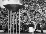 Helsinki 1952: Finnish runner Paavo Nurmi, a former gold medalist, lights the Olympic flame at the Opening Ceremony.