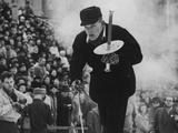 Oslo 1952: Eigil Nansen, grandson of the famous explorer Fridtjof Nansen, prepares to light the Olympic flame at the Opening Ceremony.