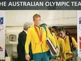 Ken Wallace walks from the plane as the Australian Olympic team arrive home following the Beijing 2008 Olympic Games.
