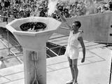 London 1948: A British athlete bears the Olympic Torch and inaugurates the 1948 Olympic Games by lighting the ceremonial flame.