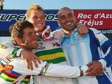 Sam Willoughby (c) celebrates victory and overall World Cup number one status alongside Donny Robinson (l) of USA and Cristian Becerine (r) of Argentina during the UCI BMX Supercross World Cup at Roc d'Azur Frejus on October 10, 2009 in Frejus, France.