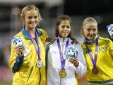 Gold medalist Sweden's Angelica Bengtsson (C), silver medalist Australia's Elizabeth Parnov (L) and bronze medalist Ganna Shelekh pose for a group photo during the awarding ceremony for girls' pole vault final A.