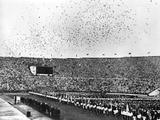 Helsinki 1952: Thousands of carrier pigeons flying over the Olympic stadium in Helsinki after they were released during the Opening Ceremony to convey the news of the Games to other countries.