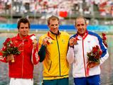 (L-R) Silver medalist Adam Van Koeverden of Canada, gold medalist Ken Wallace and bronze medalist Tim Brabants of Great Britain celebrate with their medals following the Kayak Single (K1) 500m Men Final during the Beijing 2008 Olympic Games.
