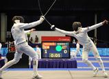 Aleix Heredia of Spain and Todd Renfree of Australia compete during the Mixed Relay Fencing match of Modern Pentathlon