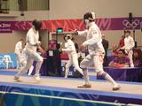 Australian modern pentathlete Todd Renfree takes on Ilias Baktybekov of Kyrgyzstand in the fencing component of the inidivudal modern pentathlon at the Youth Olympic Games.