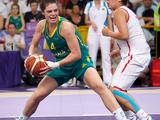 Rosemary Fadljevic (left) looks for an opening to get past China's Jin Jiabao (right) during the girls' basketball gold medal match