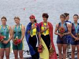 The medal winners on the podium (from left to right) Rachael Taylor and Kate Slatter of Australia (silver) Georgeta Damian and Doina Ignat of Romania (gold) and Melissa Ryan and Karen Kraft of the USA (bronze) receive their medals and listen to the Romanian anthem during the medal ceremony for the women's pair without coxswain event.