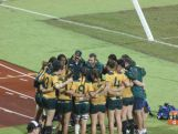 Australian rugby sevens Team huddle after facing Fiji in the 2015 Pacific Games grand final.