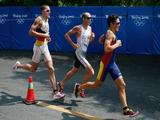 Gold medalist Jan Frodeno (L) of Germany races with Bronze medalist Bevan Docherty (C) of New Zealand in the running portion of the Men's Triathlon Final at the Triathlon Venue.