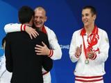 (L-R) Silver medalists Yuriy Kunakov and Dmitry Sautin of Russia stand on the podium during the medal ceremony in the Men's Synchronised 3m Springboard Final.