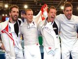 (L-R) Nicolas Lopez, Vincent Anstett, Julien Pillet and Boris Sanson of France celebrate their team sabre fencing gold medal win over the United States at the Fencing Hall of National Convention Center on Day 9 of the Beijing 2008 Olympic Games on August 17, 2008 in Beijing, China.